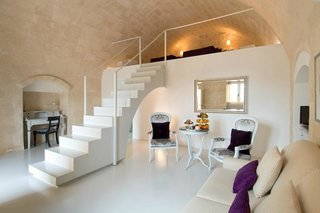 Set within the cave dwellings of the ancient Italian city of Sassi de Matera, Italy, Sant'Angelo Luxury Resort combines the curving outlines and texture of natural stone with soft, modern touches.