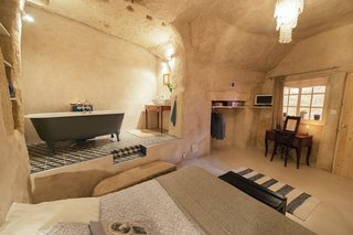 Located in converted caves in the Nazelles-Négron commune in France's Loire Valley, Amboise Troglodyte is a cozy, modern B&B that has a tiled nook bath area.