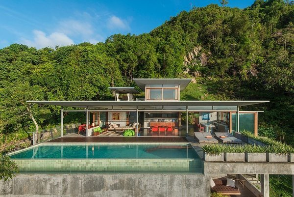 Built by architect and photographer Mark Gerritson, The Naked House is a stunning six-bedroom minimalist house on the Thai island on Koh Samui with concrete floors and plenty of outdoor space.  Photo 2 of 11 in Escape to the Jungle in One of These Modern Forested Retreats