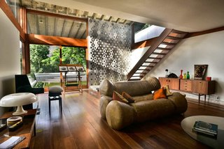 Set in a 1970s Brutalism residence designed by Brazilian architect Wladimir Alves de Souzain, and located at the heart of Santa Teresa in Rio, Chez Georges, is a nine-bedroom hillside house with soaring ceilings and a music studio that overlooks the Brazilian rainforest.