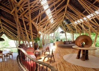 Built almost entirely with locally-sourced bamboo, the Green Village residential community in Ubud, Bali, is a sculptural house designed by Elora Hardy of Ibuku. It's available to rent through Airbnb.