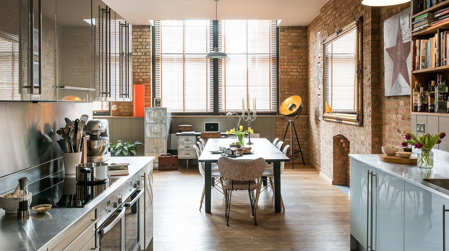 With exposed brick walls, an old metal work desk and roof terrace herb garden, Ny-Lon, located in a warehouse building in Shoreditch, brings a touch of working-class cool to your stay.  Photo 5 of 10 in Soak Up the Creative Vibes of London's East End at One of These Rental Homes or Hotels