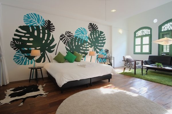 The Fern Suite is a colorful, tropical space that fits three to six guests comfortably.