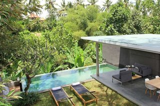 Located in the artsy town of Ubud, and nestled within a verdant green valley, the eco-friendly Aria Villas was designed by Singapore architect Chioh-Hui Goh, and offers a fresh take on Balinese style.