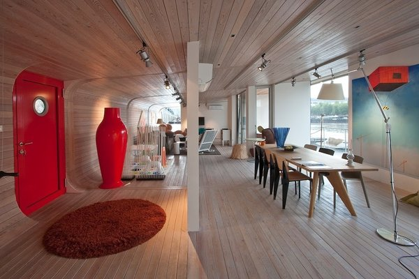 Moored in the stylish area of Holesovice in Prague, the sleek and contemporary Port X houseboat has floor to ceiling windows, outdoor terraces, fully-equipped kitchenett, Italian sofa bed from Vlbieffe and Bang Olufsen sound system.  Photo 5 of 11 in Make Yourself at Home in One of These Small Spaces on Boats That You Can Rent