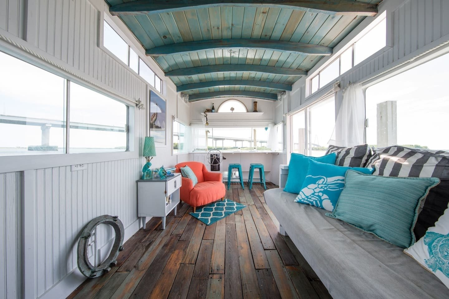 Located in a peaceful marine in downtown Charleston, Carolina, this compact and cozy houseboat was gutted and refurbished with reclaimed materials and comfortably sleeps three.  Photo 6 of 11 in Make Yourself at Home in One of These Small Spaces on Boats That You Can Rent