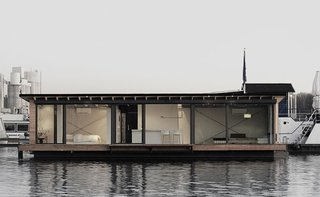 Moored in Lake Rummelsburg in Berlin, this 60-square-meter houseboat has full-height windows that open to views of the water and the city horizon. It has a large living area, open kitchen, and a fireplace—and can comfortably accommodate two adults and two children.