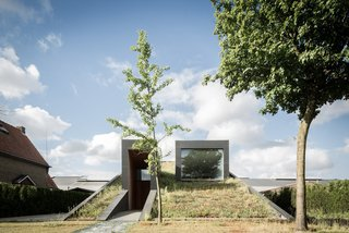 A Compact Home That Literally Pops Up From the Grass