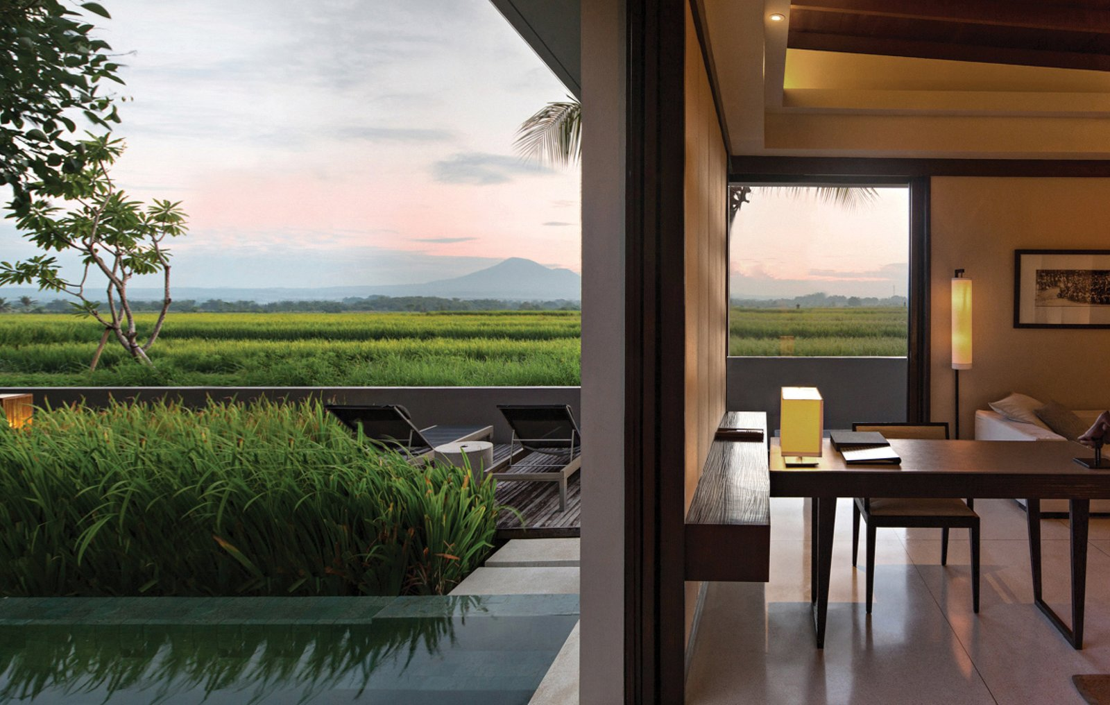 Outdoor, Infinity Pools, Tubs, Shower, Trees, Wood Patio, Porch, Deck, Shrubs, Back Yard, Swimming Pools, Tubs, Shower, and Large Pools, Tubs, Shower  Photo 5 of 9 in A Modern Bali Resort That's Inspired by the Local Landscape and Culture