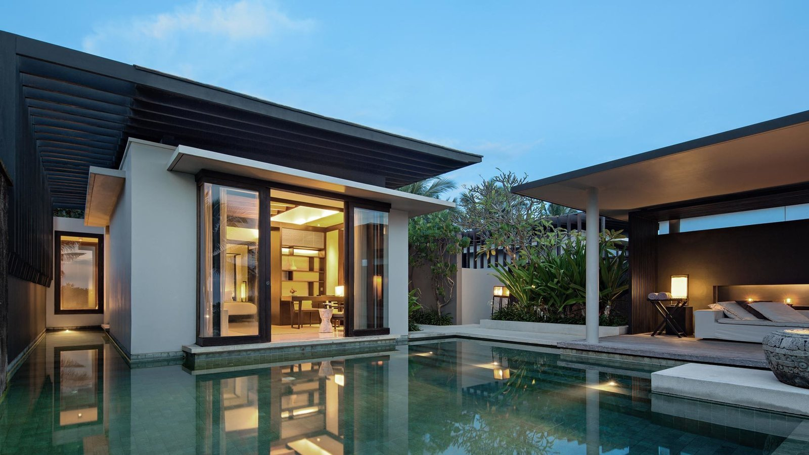 Outdoor, Large Pools, Tubs, Shower, Swimming Pools, Tubs, Shower, Infinity Pools, Tubs, Shower, Back Yard, Trees, Hardscapes, Shrubs, and Concrete Patio, Porch, Deck  Photo 8 of 9 in A Modern Bali Resort That's Inspired by the Local Landscape and Culture