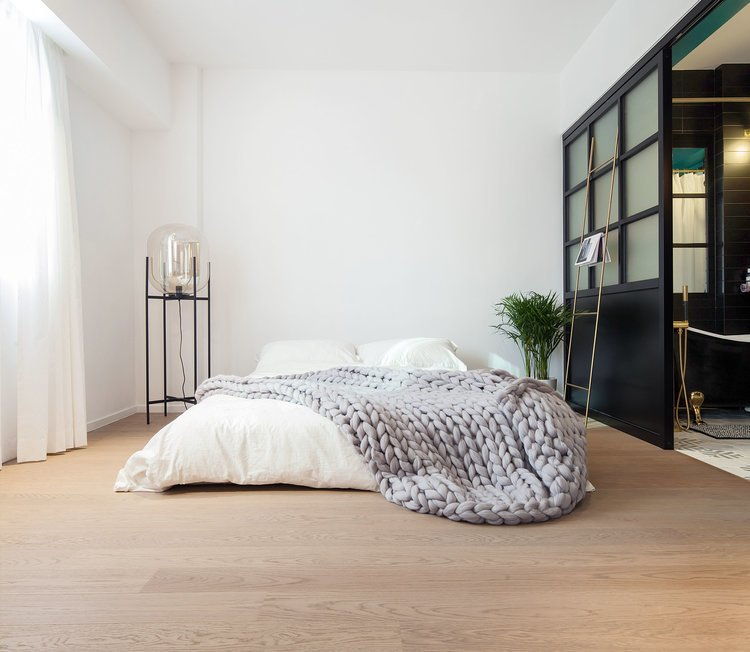 Bedroom, Bed, Floor Lighting, and Light Hardwood Floor  Photo 4 of 7 in See How This Colorful Hong Kong Apartment Was Made to Feel Bigger Than it Actually Is