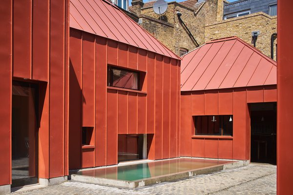 Red Tin House That Makes the Most of Space and Light