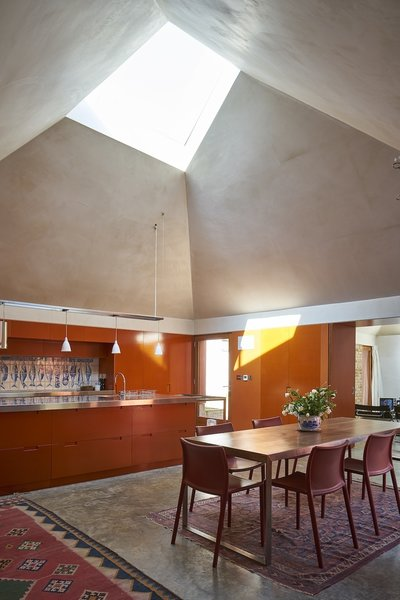Concrete Floor, Pendant Lighting, and Dining Room  Photo 3 of 10 in Red Tin House That Makes the Most of Space and Light