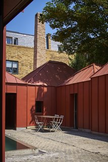 Red Tin House That Makes the Most of Space and Light - Photo 9 of 9 -