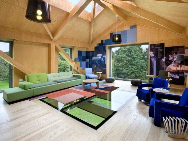 Living Room, Sofa, Ottomans, Coffee Tables, Chair, Pendant Lighting, and Light Hardwood Floor  Photo 4 of 11 in Take a Modern British Holiday in a Gleaming Cantilevered Barn