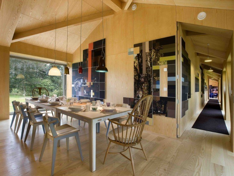 Dining Room, Pendant Lighting, Light Hardwood Floor, Table, and Chair  Photo 7 of 11 in Take a Modern British Holiday in a Gleaming Cantilevered Barn