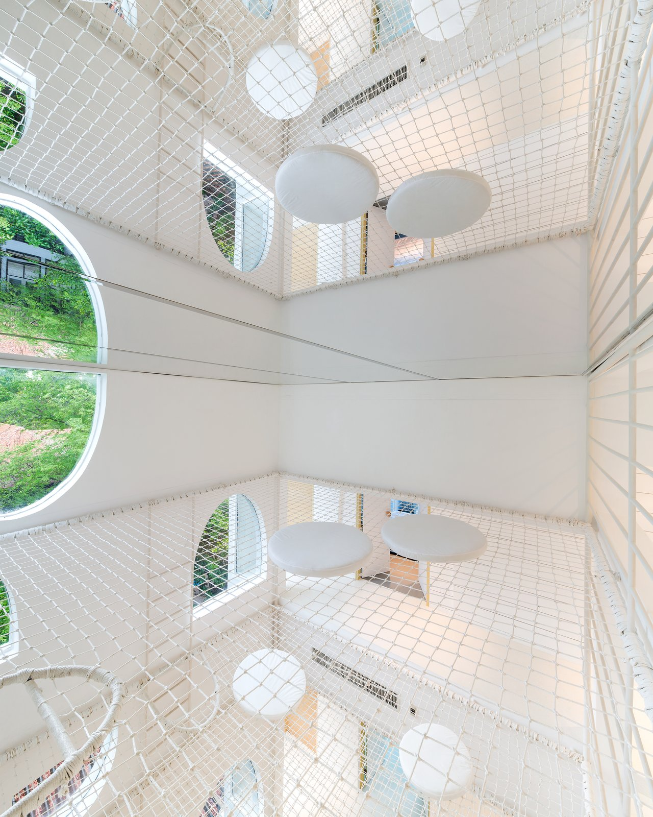 Photo 11 of 11 in Inspired by Tom and Jerry, This Net-Filled Vacation Home Is a Kid's Paradise