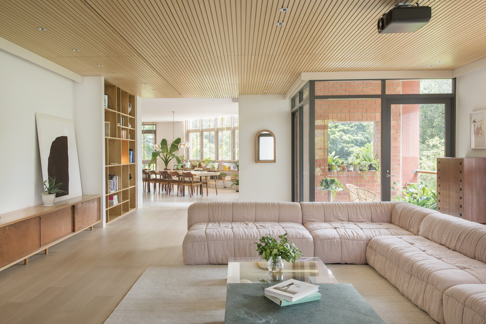 Living Room, Coffee Tables, Sectional, Recessed Lighting, Light Hardwood Floor, Rug Floor, and Storage  Photo 2 of 10 in The Light and Airy Apartment G in Downtown Singapore