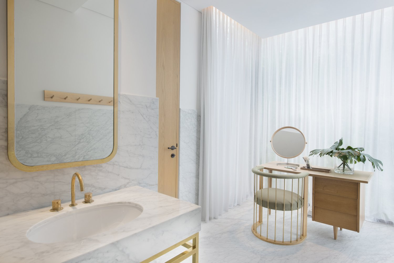 Bath Room, Undermount Sink, Marble Wall, Marble Counter, and Marble Floor  Photo 6 of 10 in The Light and Airy Apartment G in Downtown Singapore