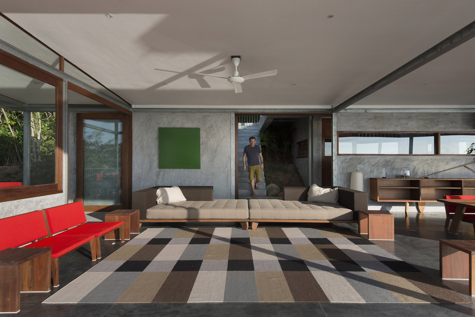 Infinity, Living, Wood, Concrete, Trees, Side Yard, Chair, Recessed, Sofa, Concrete, End Tables, Shelves, and Rug  Living Trees Wood Photos from Take a Trip to This Photographer-Designed Concrete Home in Thailand