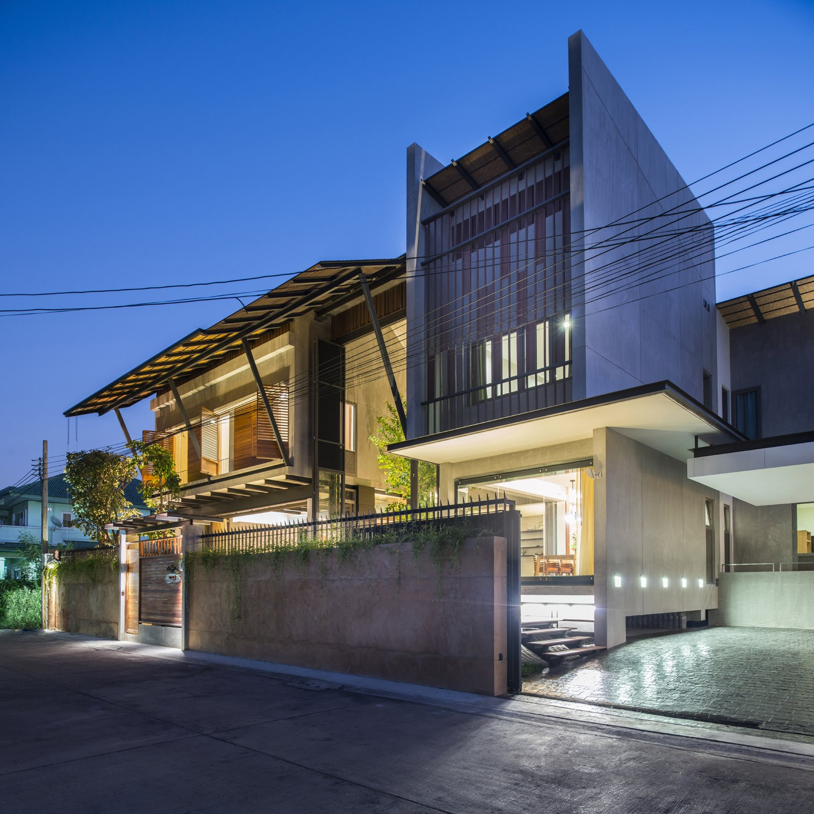 Exterior and House Building Type  Photo 9 of 11 in Cool, Asian Courtyard Home With A Brutalist Core