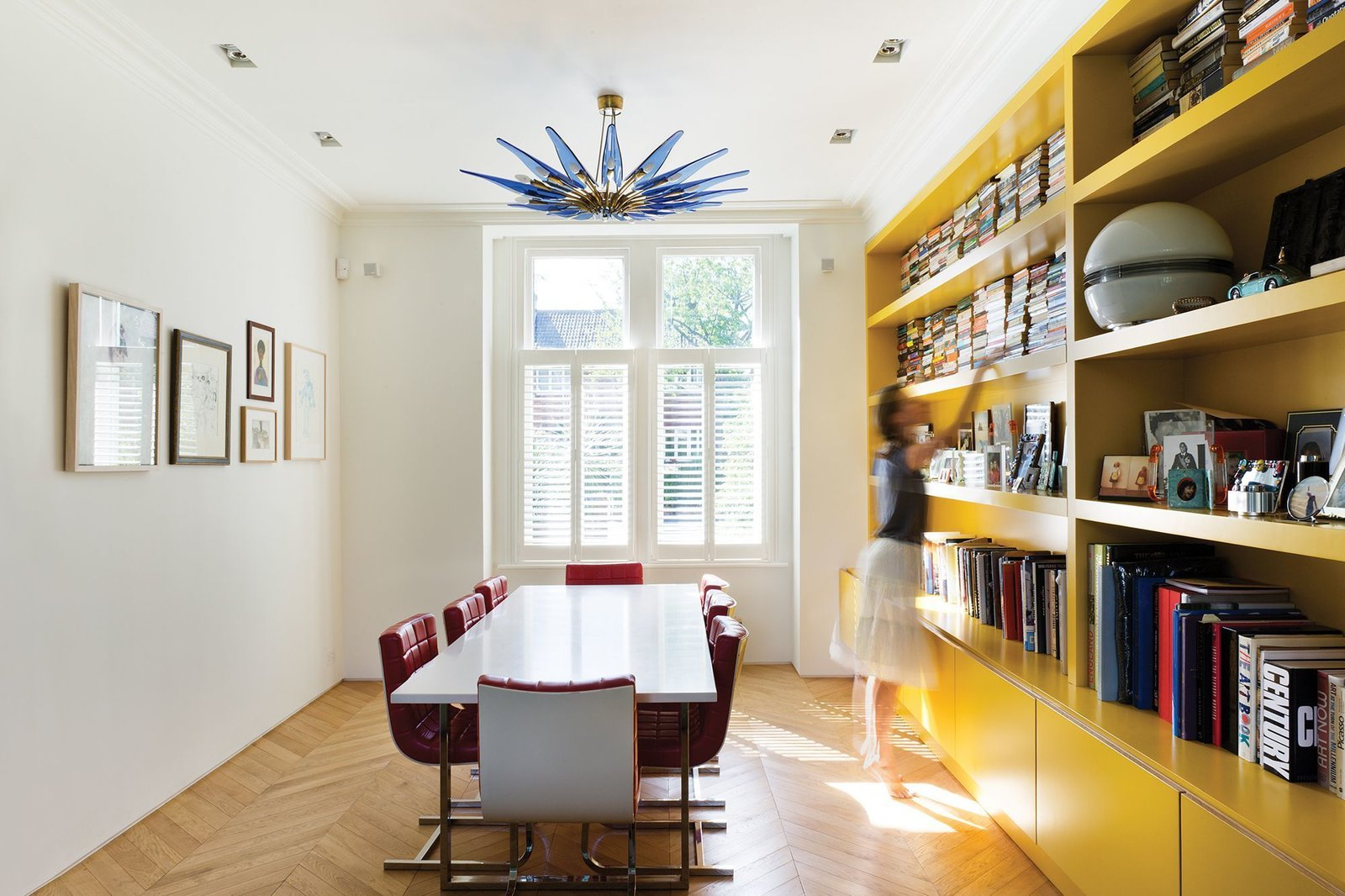 Storage, Sofa, Dining Room, Shelves, and Light Hardwood Floor  Photo 4 of 13 in Bright Bauhaus Colors Fill This Brick Edwardian House in London