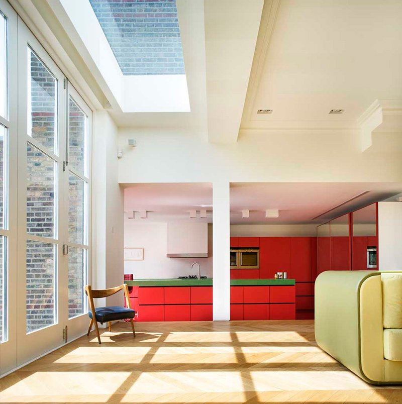 Storage, Light Hardwood, Sofa, Shelves, Table, Drop In, Kitchen, and Colorful  Best Kitchen Table Colorful Photos from Bright Bauhaus Colors Fill This Brick Edwardian House in London