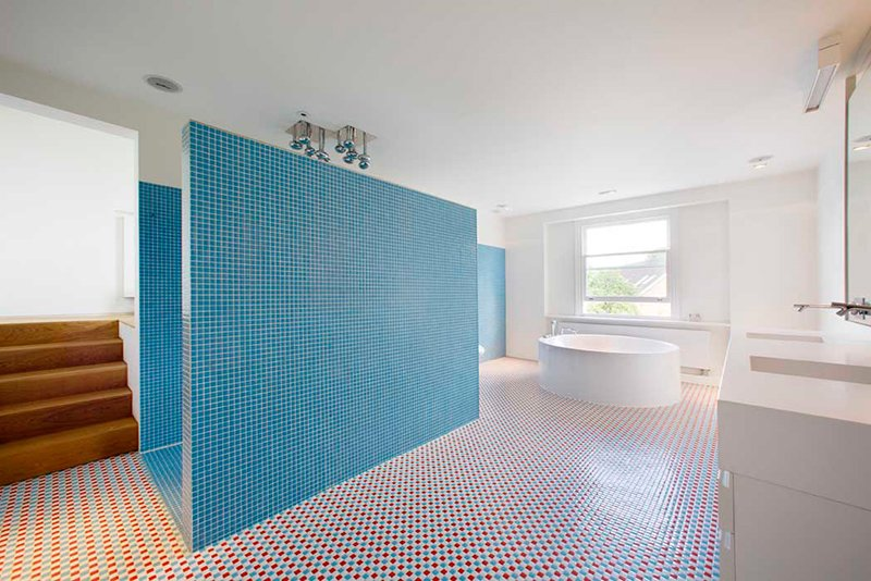Storage, Bed, Freestanding Tub, Table, Shelves, Light Hardwood Floor, Bath Room, Soaking Tub, and Ceiling Lighting  Photo 11 of 13 in Bright Bauhaus Colors Fill This Brick Edwardian House in London