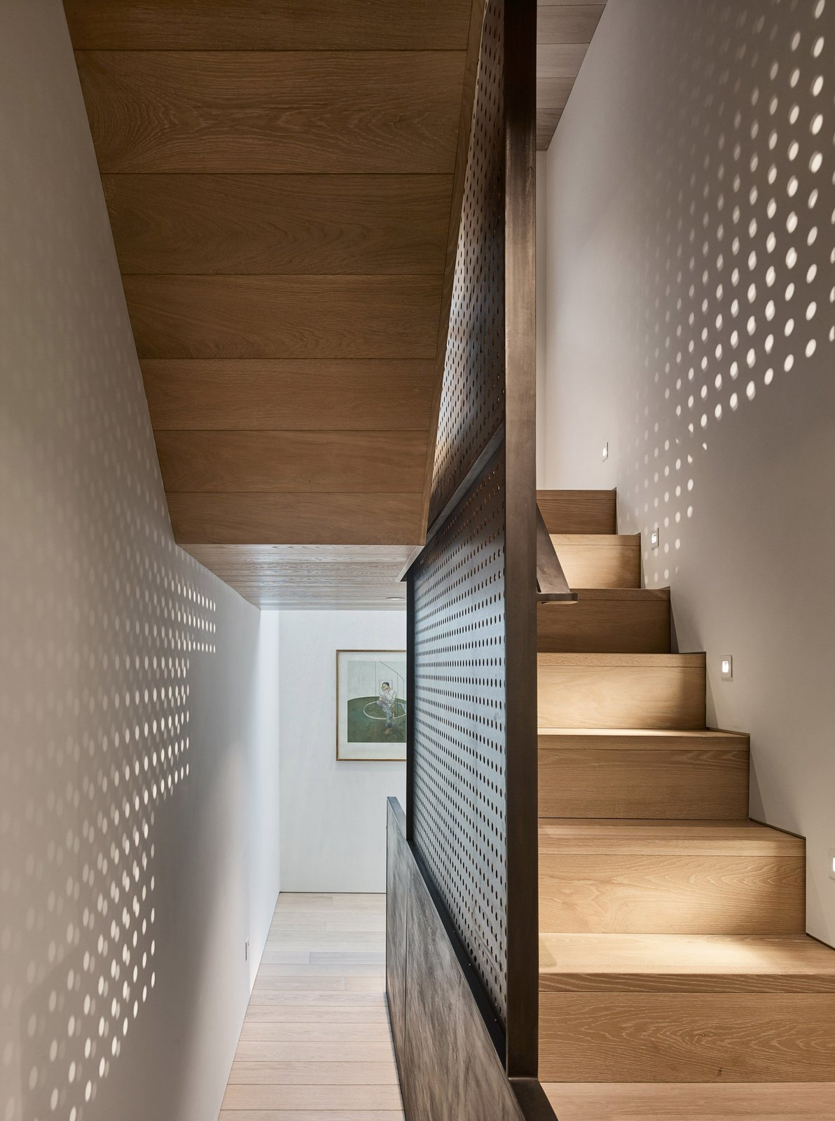 Staircase and Wood Tread  Best Photos from Transparent Perforated Circles Bring Light and Movement to This London Terrace House