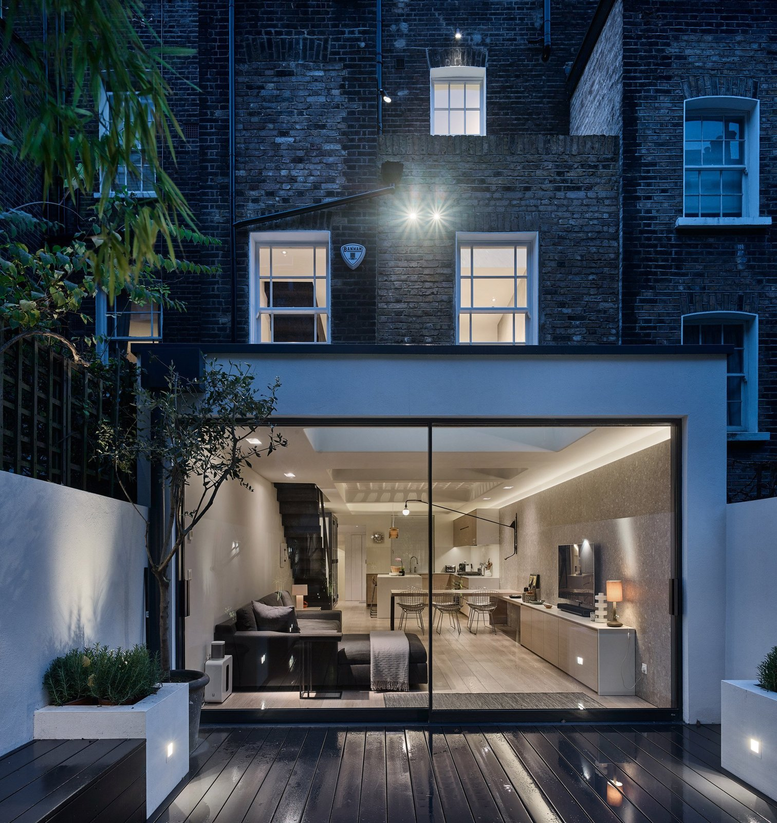 Outdoor, Small Patio, Porch, Deck, and Wood Patio, Porch, Deck  Best Photos from Transparent Perforated Circles Bring Light and Movement to This London Terrace House