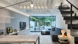 Transparent Perforated Circles Bring Light and Movement to This London Terrace House - Photo 2 of 11 -
