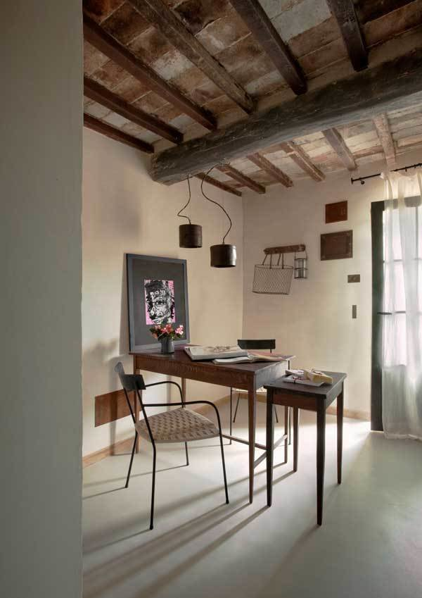 Office, Chair, Concrete Floor, and Desk  Photo 4 of 10 in Rustic Meets Modern In This Tuscan Village Boutique Hotel
