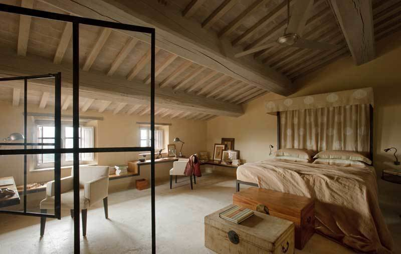 Bedroom, Storage, Chair, Bed, Table Lighting, and Concrete Floor  Photo 6 of 10 in Rustic Meets Modern In This Tuscan Village Boutique Hotel