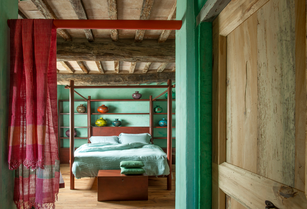 Bedroom, Bed, Bench, and Medium Hardwood Floor  Photo 2 of 10 in Rustic Meets Modern In This Tuscan Village Boutique Hotel