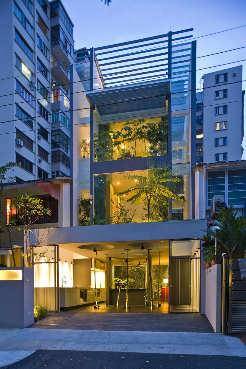 Sofa, Ceiling Lighting, Dark Hardwood Floor, and Outdoor  Tree House at Jalan Elok from This Modern Home in Singapore Is a Living Urban Jungle