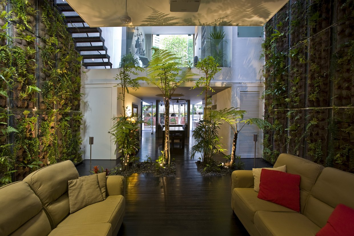 Sofa, Front Yard, Metal Tread, Wood Patio, Porch, Deck, Trees, Dark Hardwood Floor, and Living Room  Photo 5 of 13 in This Modern Home in Singapore Is a Living Urban Jungle