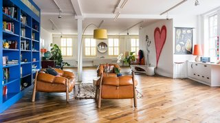 "Indoor graffiti, wacky artwork, colors that pop, a red ""papa bear"" lounge chair, and a 3,000-square-foot living area are just some of the reasons why this apartment is a one of the most sought-after holiday rentals in the artsy neighborhood of Shoreditch."