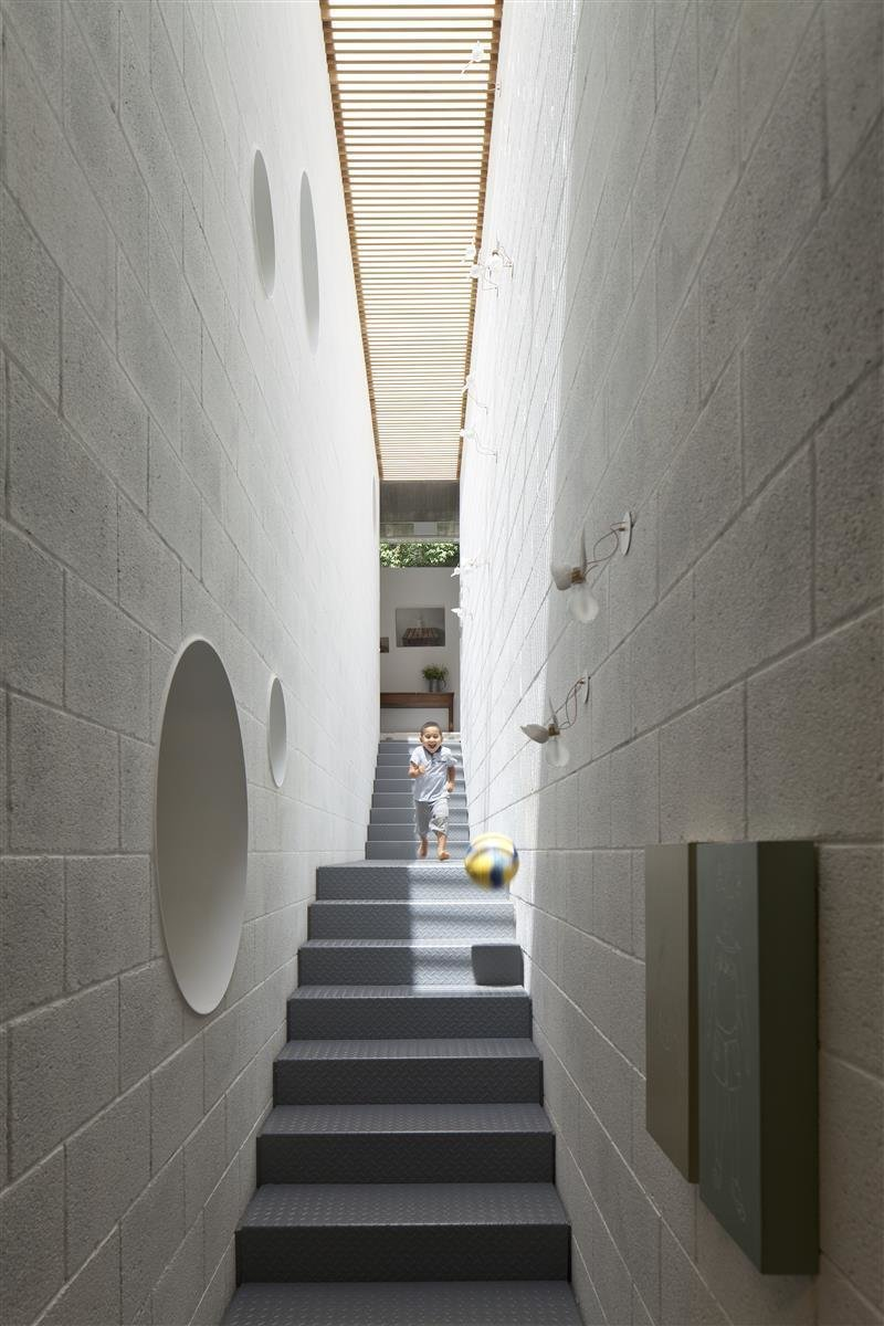 Staircase and Metal Tread  Best Photos from An Architect's Bright and Airy Family Home Thrives Within a Brutalist Concrete Structure
