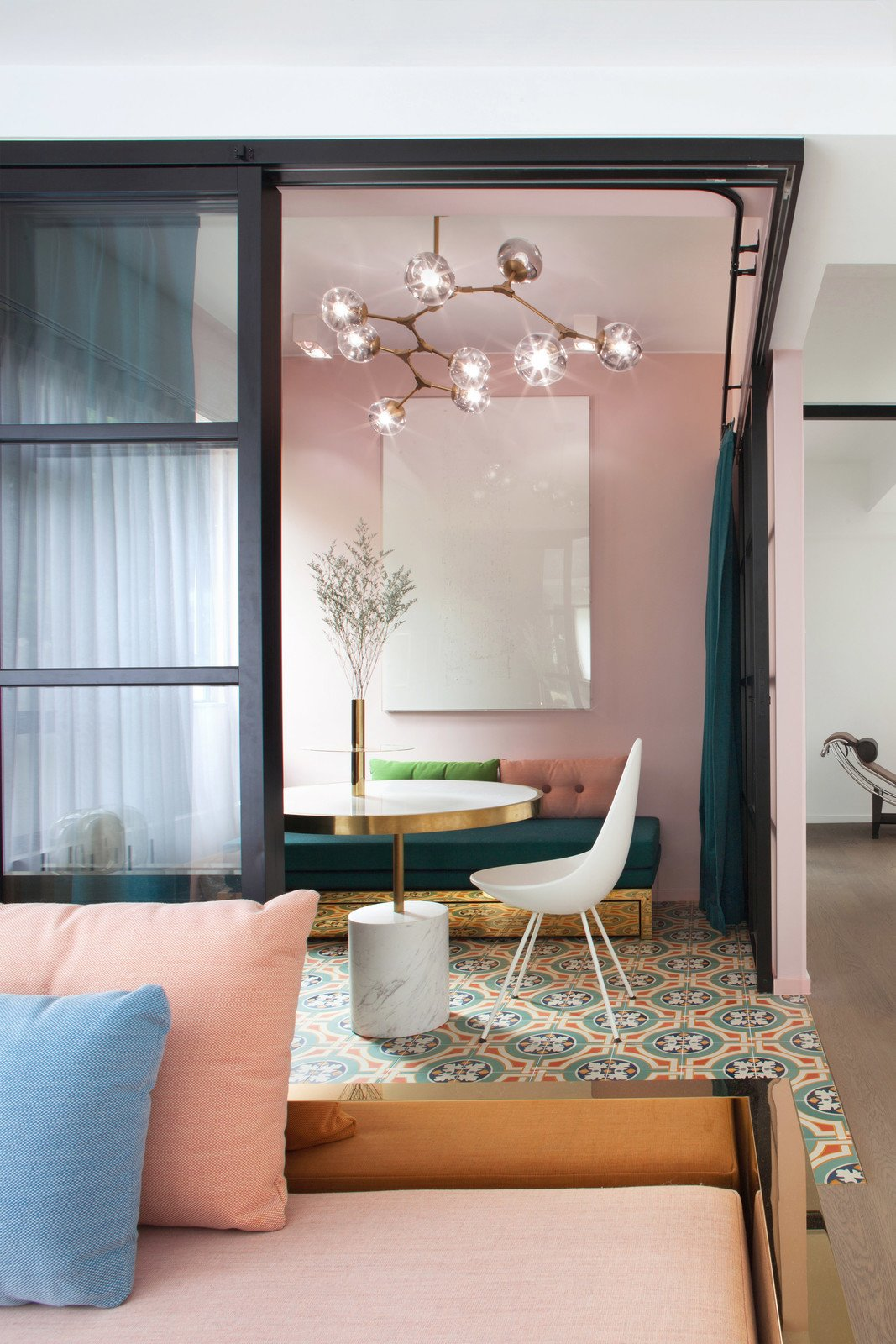 Lim+Lu combined muted pink, deep blue and turquoise, ceramic tiles with striking patterns, black-and-white accents, and splashes of gold when remodeling this contemporary Art Deco-inspired apartment in Hong Kong.  Photo 4 of 10 in 9 Small Spaces With  Color