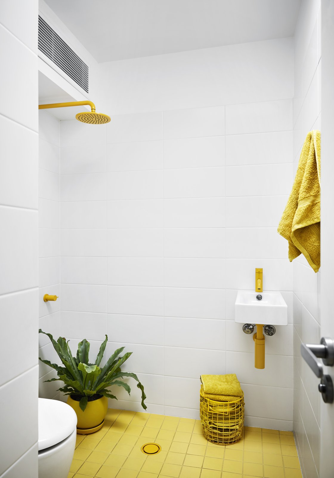 Bath Room, Ceramic Tile Floor, Wall Mount Sink, Open Shower, and Ceramic Tile Wall  Photo 8 of 12 in An Architect Turns His Victorian Home Into a Sun-Drenched Live/Work Space