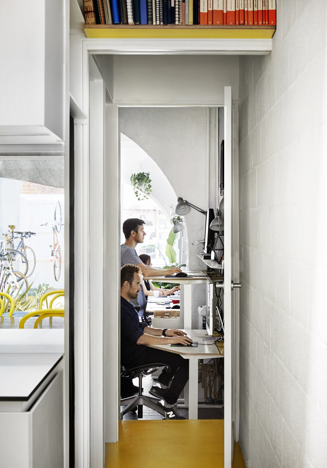 Office, Study Room Type, Chair, Desk, and Lamps  Photo 4 of 12 in An Architect Turns His Victorian Home Into a Sun-Drenched Live/Work Space