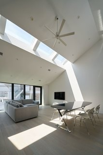 Australian practice PandA Studio Architecture designed House Nakamaruku in Kanagawa, Japan, with skylights on the upper level that bring in plenty of natural light without compromising privacy.