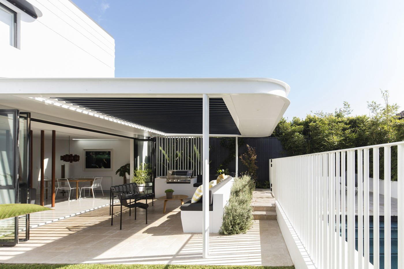 Outdoor, Back Yard, Trees, and Metal Fences, Wall  Photo 6 of 11 in A Heritage Art Deco House in Australia Gets a Modern Update
