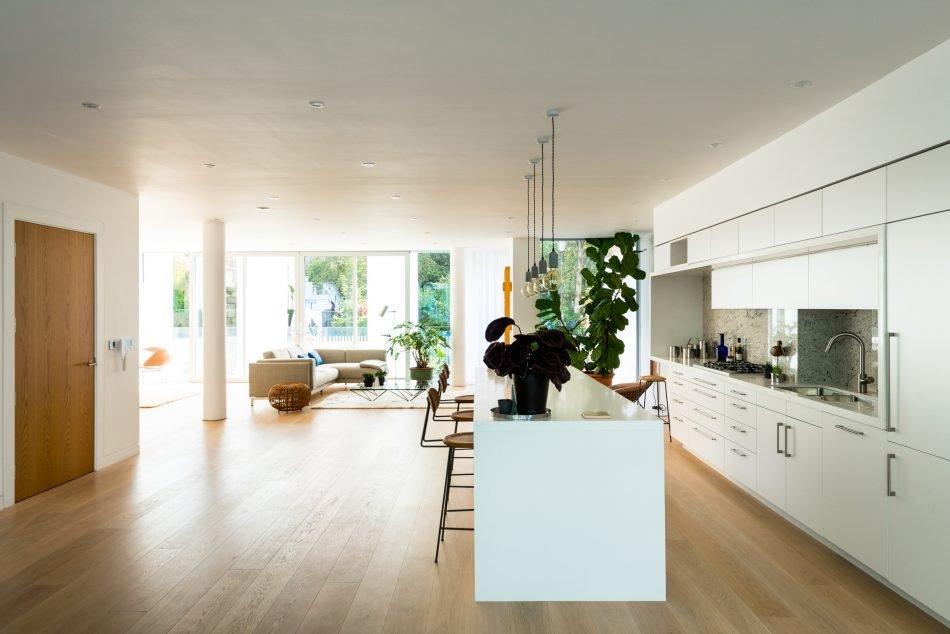 Kitchen, Light Hardwood Floor, Engineered Quartz Counter, White Cabinet, Pendant Lighting, and Undermount Sink  Photo 4 of 13 in Sleek, Modern Loft Apartments For Sale in a Heritage Neighborhood of London