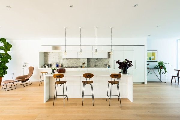 Kitchen, Engineered Quartz Counter, White Cabinet, Light Hardwood Floor, Pendant Lighting, Range, and Undermount Sink  Photo 10 of 13 in Sleek, Modern Loft Apartments For Sale in a Heritage Neighborhood of London