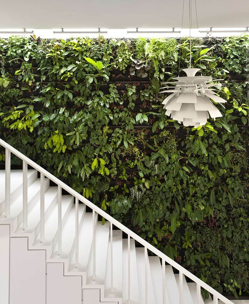 "This house, aptly named ""The Gardener"" by Singapore practice Park+Associates Architects has a green wall covered in plants next to the staircase that leads up from the ground to the upper level of the house.  Photo 9 of 10 in 10 Ways to Create an Uplifting Vertical Garden"