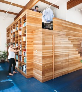 When renovating his home in Emeryville, California, architect Peter Benoit of Melander Architects custom-designed a 16-by-17-by-10-foot wooden box that accommodates a bedroom within, a dressing room mezzanine above, and a bookcase on one of its sides.