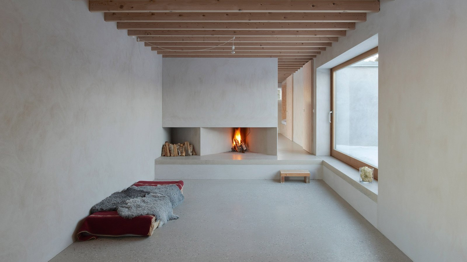 Living Room, Standard Layout Fireplace, Concrete Floor, and Wood Burning Fireplace  Photo 5 of 7 in 7 Tips For Creating Your Own Home Meditation Zone