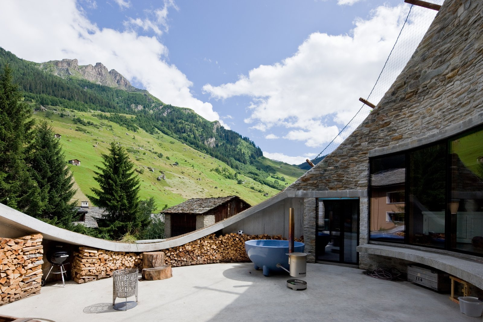 Outdoor, Trees, and Concrete Patio, Porch, Deck  Photo 2 of 13 in Stay in a Swiss Vacation Home That's Literally Inside a Mountain