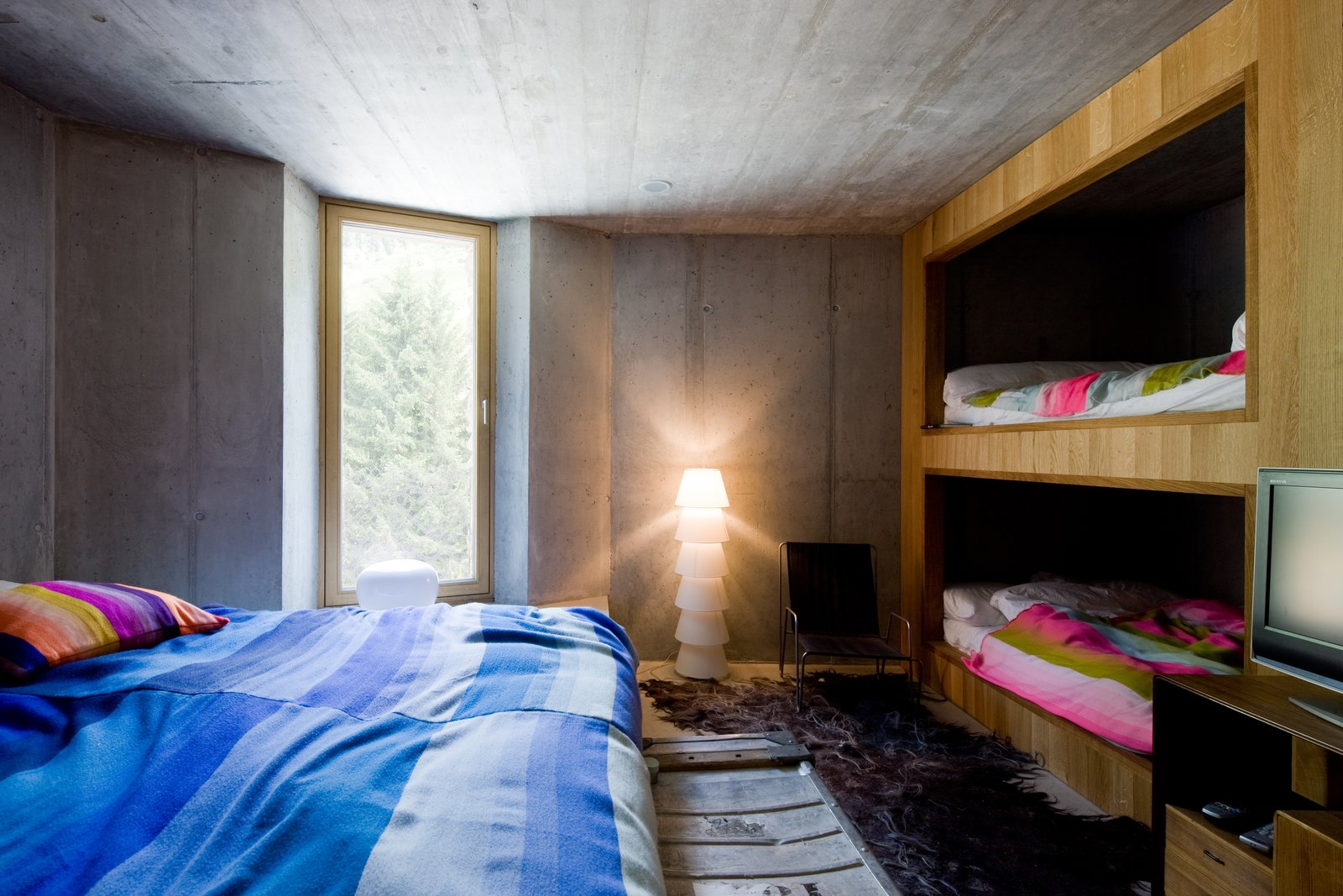 Kids, Bed, Bunks, Bedroom, Teen, Pre-Teen, Neutral, Chair, Lamps, and Rug  Best Kids Neutral Bunks Photos from Stay in a Swiss Vacation Home That's Literally Inside a Mountain